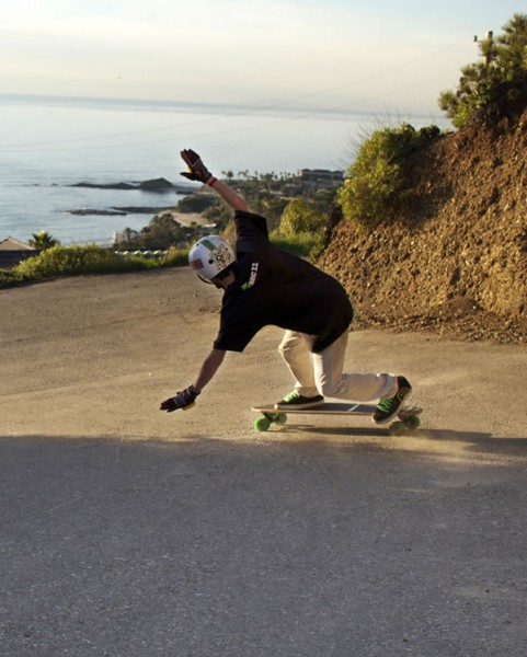 A local skateboarder  practicing in a driveway.
