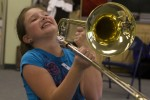 McKayla Brooks, 8, of Laguna is tickled by the sounds she coaxed from a trombone.
