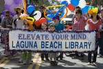 Supporters of the Laguna Beach Library march on Forest Ave. Photo by Ted Reckas.