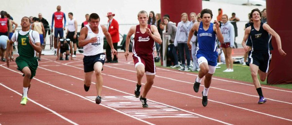 Sophomore Barton Reece drives to the finish in the first heat of the frosh/soph 100-meter dash.