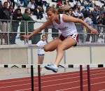 Senior Christa French clears the final hurdle on her way to a second place finish. Photos by Robert Campbell