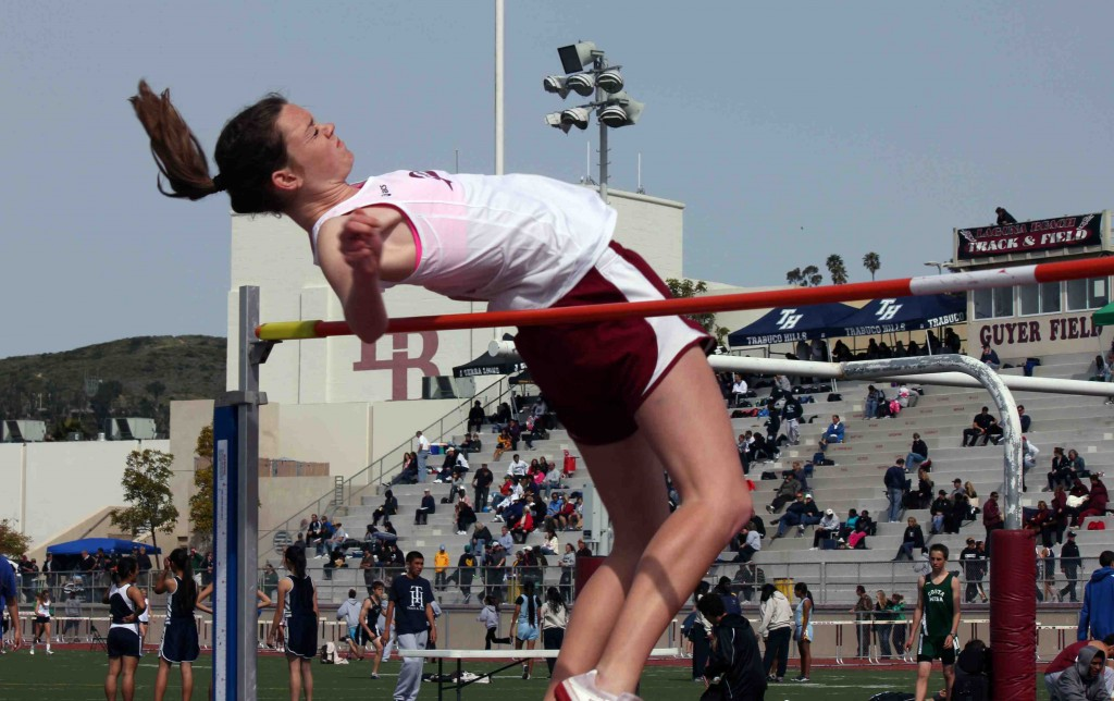 Laguna senior Christianne Kinder leaps to first place in the high jump.