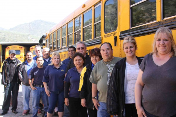 The student-driving bus crew at Durham's Laguna yard.