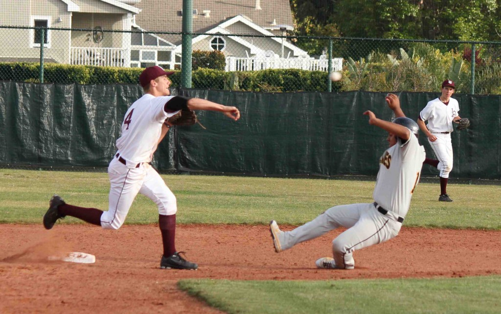 After tagging the runner at the bag, Austin Paxson tries for a double play at first in a recent game.