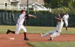 After tagging the runner at the bag, Austin Paxson tries for a double play at first in a recent game. Photos by Robert Campbell