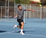 Laguna's No. 1 singles player Jake Michaels charges the net during a 6-1 rout of Cerritos' top player, Pilki Min. Photo by Bob Campbell.