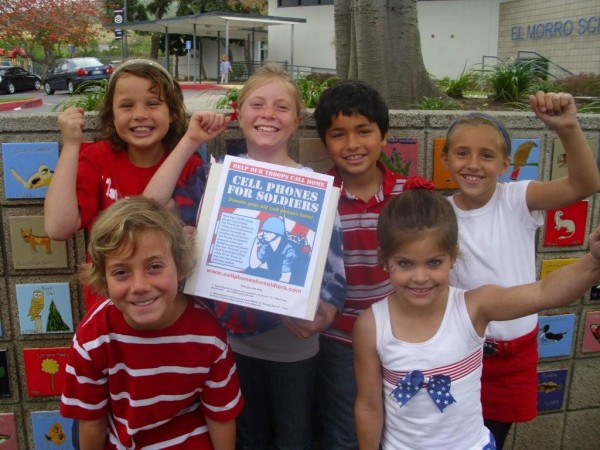 Patriotically dressed students surround a collection box, back row from left, Isabel Meekma, Olivia Shipp, Matthew Gallegos and Grace Fink; front row, Zachary Cord and Caroline Herry.