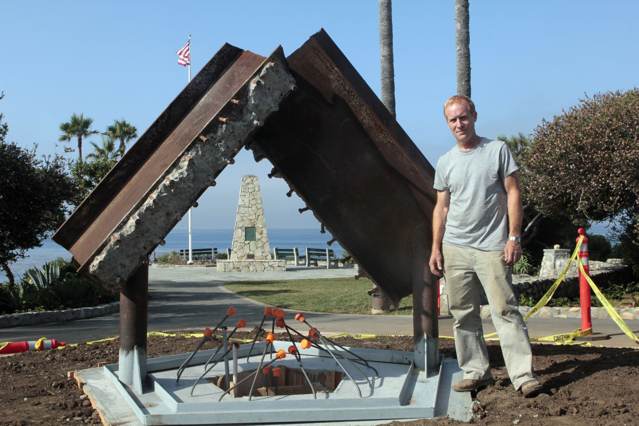 Jorg Dubin at Heisler Park's Monument Point with his Sept. 11 memorial in progress. Photo by Ted Reckas.