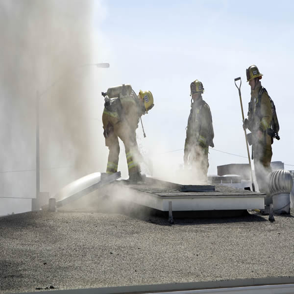 Laguna firefighters battle a blaze in a downtown store last March.