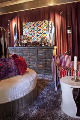 Interior designer Sheldon Harte's lounge features an Albert Contreras painting over an antique chest from Lee Stanton in Costa Mesa and spot lights from Fuse Lighting.