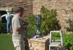 Artist John Barber installs newly created urns for the Montage resort.