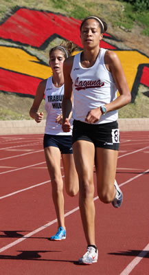 Natasha Strickland set the school record in the 3200 meter race in track.