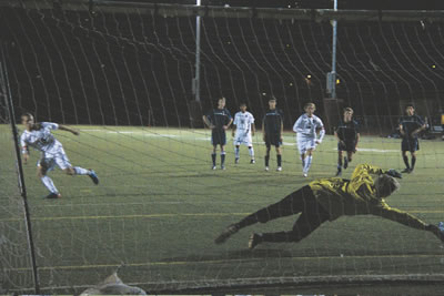 Breaker mid-fielder Reece Barton scores the winning goal against Calvary Chapel on a penalty kick in the 82nd minute.