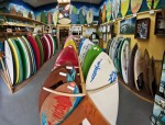 Victoria Skimboard's Laguna Canyon showroom, stocked with beginners' wood boards to high performance pro models, is ringed by owner Tex Haines' personal collection of vintage skimboards, giving customers a visual history of the sport.