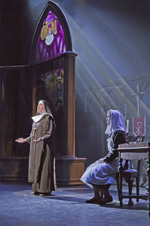 "Haley Castuera, the mother abbess, urges Chandler Davis' Maria to ""Climb Ev'ry Mountain"" in the high school production of ""Sound of Music."""