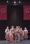 "The guitar-playing captain, Jackson Tupy, his bride and brood perform ""Edelweiss"" in a climactic scene at the Kalzberg Music Festival."