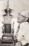 Jack Norworth with the trophy presented to him in 1958 by the Los Angeles Dodgers, now passed to Laguna's Little League major champs each year.