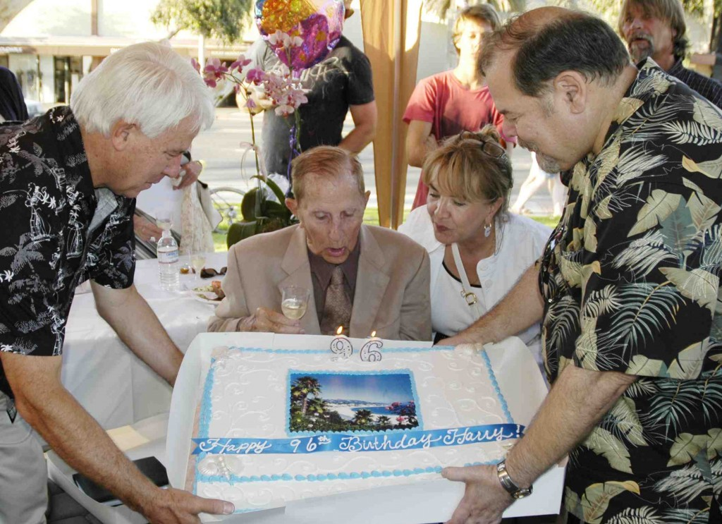 Community leaders join with Harry Lawrence in celebrating his birthday in 2010.