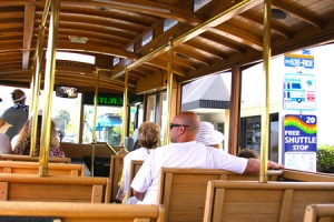Last summer's trolley riders hop a free ride towards downtown Laguna Beach.