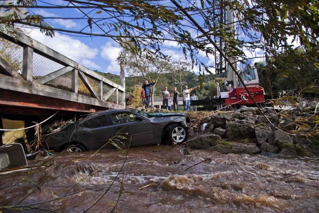 A crane was used to extract Carter Pike's car from beneath a bridge near the Canyon Club last Thursday. Photo by Mitch Ridder