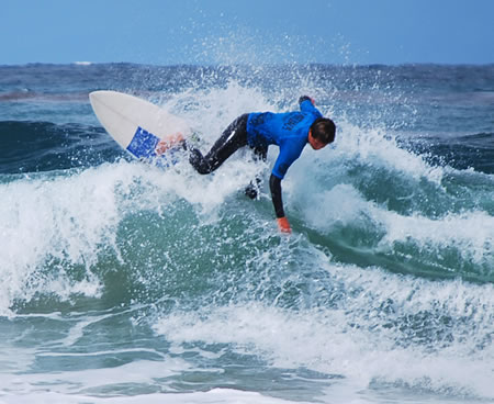 High school surfer Harrison Kirkman competes in the Thalia Street Surfabout contest.