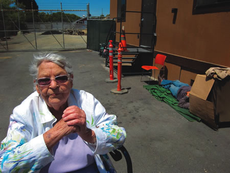 Jean Raun, 89, discusses the cost benefit of permanent housing for the homeless, envisioned on a city owned lot near the existing shelter.  Photo by Marilynn Young