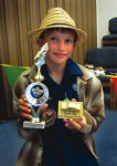 "Ten-year-old Emerson Gallard's ""Mach 5"" won all 18 heats in the pinewood derby race."