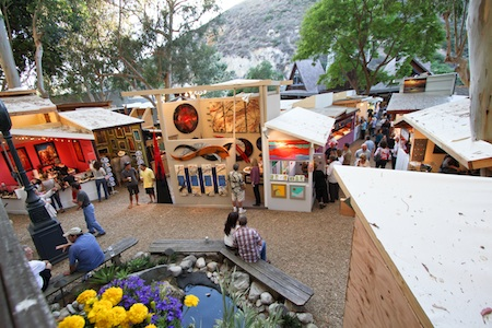 With Sawdust Festival artists allotted half as many tickets as the year before, visitors enjoyed breathing room during the preview night this week.  Photo by Jody Tiongco