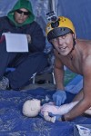 Nick Baum, of Aliso Viejo, provides infant CPR while keeping an eye on the water as Capt. Tom Trager scores his performance.