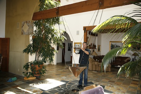 Laguna Beach architectural designer Phillipe Horvath and the fountain he designed for his parents Top of the World home.