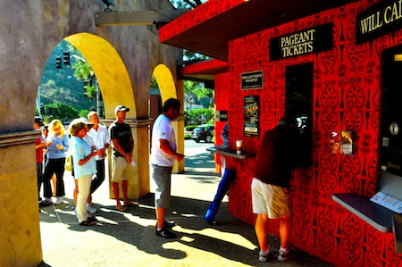 Last-minute buyers line up for pageant tickets at the Festival of Arts box office, which often has better deals than brokers. Photo by Drew Lovato
