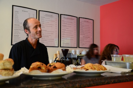 Ferdinand Lettner behind the counter at his latest restaurant endeavor, Thalia Beach Café. Photo by Danielle Robbins