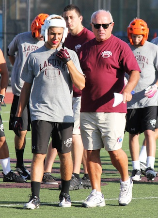 Second year coach Mike Churchill offers advice during practice.