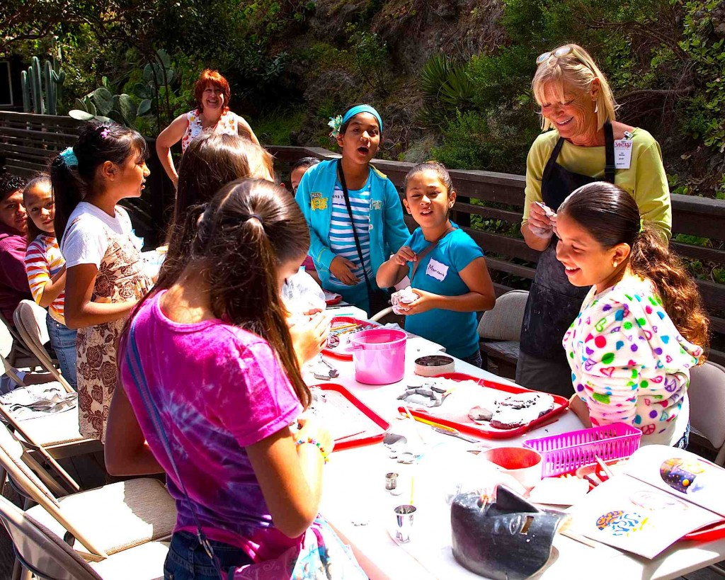 Laguna Beach's Ora Sterling demonstrates mask-making to aspiring artists.