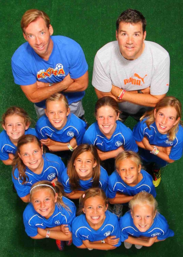 Winning a national AYSO cup: front, Hallie Carballo, Peri Brennan and Jordan Morris; second row, Riley Russo, Anika Nielsen and Morgan Van Alphen; third,  Ella Pachl, Kennedy Barlow, Cosette Chesley and Piper Naess; back, coaches Ole Nielsen and Kent Pachl.