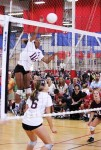 High-flying sophomore # 5 Alyse Ford returns to the court, one of high school volleyball's most dominating hitters. Photo by Robert Campbell