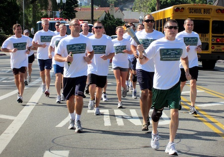 Darin Lenyi carries the Olympic torch in a relay in a previous relay.