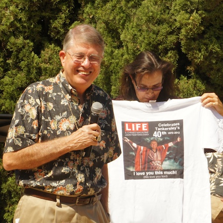 Rev. Tankersley accepts a t-shirt with a faux Life magazine cover that likens him to Moses. Photo by John Cullings.