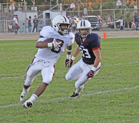 Senior wingback Robert Clemons eludes a Bolsa Grande defender on his way to an 86-yard kick off return for a touchdown. Photo by Robert Campbell