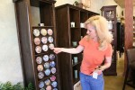 Judy Kelly in her candle boutique Pure Light, where she turned to keep her son's memory alive.
