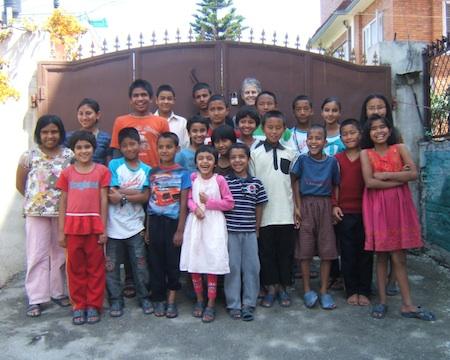 Local Chris Casey and the brood of children in the shelter she established in Nepal.
