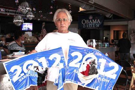Ruined Obama signs turned into to the Democratic Club held by board member Nick Hernandez.