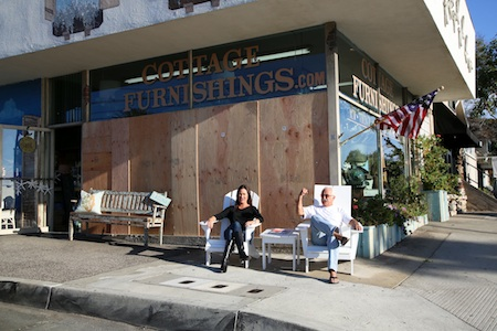 Co-owner Lewis Tarter, and his daughter, outside Cottage Furnishings, one of seven Laguna Beach businesses whose windows were shot out early Sunday morning by vandals.