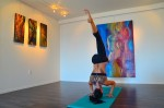 Entrepreneur and yoga master Gabby Levine, owner of Ritual Yoga Arts, practices yoga in the presence of works by Amber Rose Tibb. Photo by Danielle Robbins