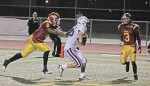 Junior running back Nathan Lancaster hauls in a pass from Larry Stewart for one of his four TDs on the night against Estancia.