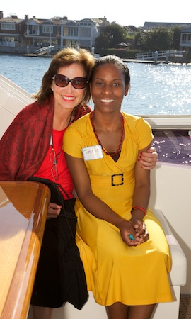 Mary Ellen Carter with Tasmim Mapira, of Malawi, visiting U.S. sponsors of her education during a recent trip.