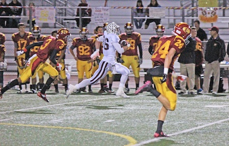 Senior running back Drake Martinez breaks free on his way to the end zone for one of his three TDs against Estancia.