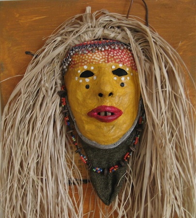 A mask by Marge Naiman is part of the mix of media exhibited in the Susi Q show.