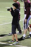 Seventh-grader Dante Fornaro talked his way onto the sidelines to become the semi-official LBHS football photographer. Photo by Robert Campbell