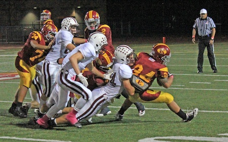 Senior defensive end Spencer Anderson stops Estancia running back Robert Murtha for no gain in Laguna's road victory over their league rival. Photo by Robert Campbell